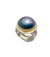 Sterling silver band with blue mabe pearl set in 14K gold.