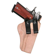 This inside the waistband holster combines superb concealment and comfort with quick presentation ability.  The holster is constructed of roughout cowhide for durability and natural adhesion to clothing.  The belt loops are interchangeable for different belt widths and belt colors.  Smooth internal construction, stitched sight rails, and a combat grip allow an easy pull from the holster.  To ensure one handed reholstering, the Summer Cruiser features a metal reinforced mouth that will not allow the holster to close upon draw.  Our body-protected flap ensures that the safety, beavertail or hammer will not rub uncomfortably during use.