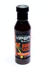 Devil's Butt Viper Sauce  For those who love hot and spicy. This sauce has a unique blend of three chilies including Chinese Red, Chipotle and Cayenne peppers. It has a perfect balance of sweetness with a fiery finish. Perfect for recipes and extra spicy BBQ meats.   Bottles can not be shipped to Alaska.