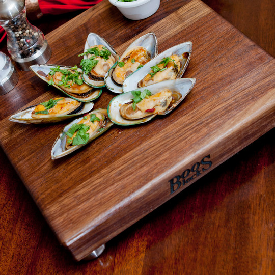 Small food boards with stainless steel feet.