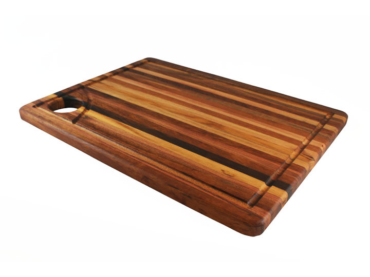 A carving board may seem like a luxury when you pull it out only a few times a year—but anyone who's tried carving a roast on a flat cutting board knows what a disaster that can be, with juices dribbling onto the counter from all sides. Carving boards are designed to avoid this mess.