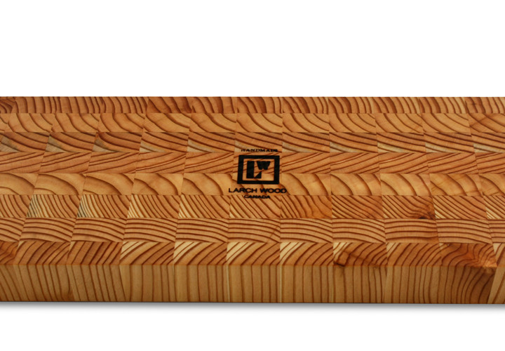 Beautiful end grain cutting board handcrafted from larchwood.