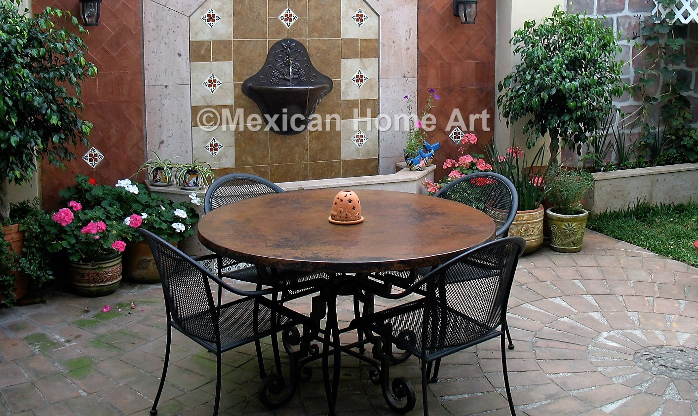 round-hammered-copper-table-top.jpg