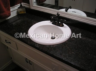 bathroom sink installed before replacing with one of our copper sinks