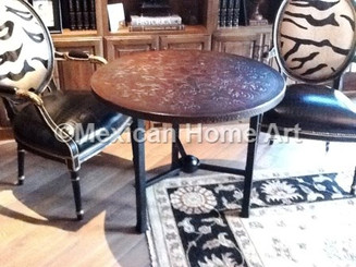 Custom Copper Table 36 inch with Fleur de Lis Antique patina Motif on Somber patina background in Customer's home