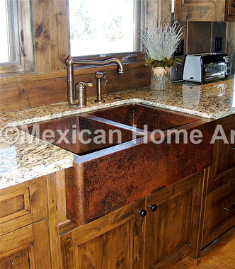 Double well copper farmhouse sink in somber patina undermount install into granite counter top