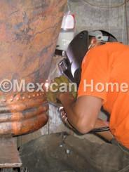 Welding the bottom of a copper bathtub