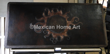 Antique patina Blazing Sun Motif on Somber patina backdrop copper table top rounded corners close up