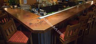 Long Copper Bar Top in the Sheraton Hotel Albuquerque close up view Somber Patina