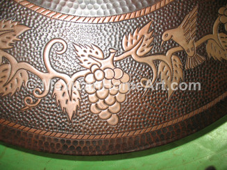 "Copper Lazy Susan 18"" Somber Patina with Grape Vine Motif close up"