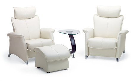 A Pair Of Fjords Ona 1 Seater Sofa Chairs Shown With Optional Accessories.