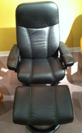 Get the best prices on our Stressless Consul Medium Reclined in Black Batick Leather.