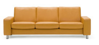 Clementine Paloma looks sharp on a Pause Sofa by Ekornes.