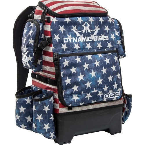 Dynamic Discs RANGER H20 BAG - Angled view of right side of bag showing cell phone pocket high up the side of the bag, and two lower pockets. Bag has blue front with large white stars. The main body of the bag has weathered red and white stripes. All pockets are also blue with white stars.