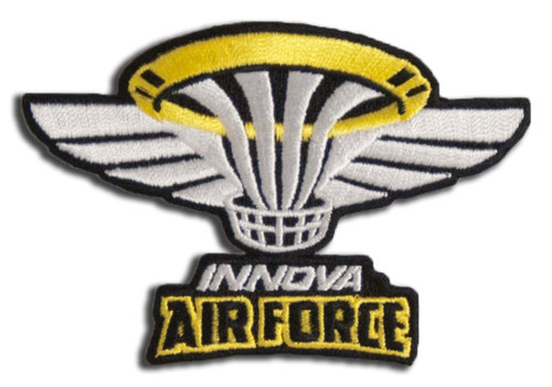 """Patch with a small white and yellow basket in the middle and white wings spreading out to the sides, with the words """"Innova Air Force"""" below it."""