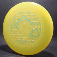 Sky-Styler 2004 Freestyle Disc World Championships Rimini White w/ Black and Orange Matte1991 World Freestyle Flying Disc Championships Yellow w/ Metallic Blue and Metallic Lemon Top View