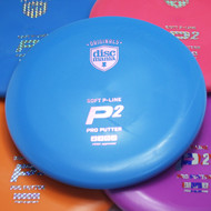 Discmania P-LINE P2 Soft. Shows five discs of different colors spread out and overlapping with a blue disc centered in the frame.