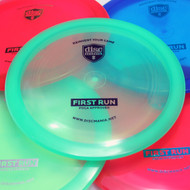 Discmania C-LINE FD2 - First Run (2019 Retool). Shows five discs of different colors spread out and overlapping, with a green translucent disc centered in the frame.
