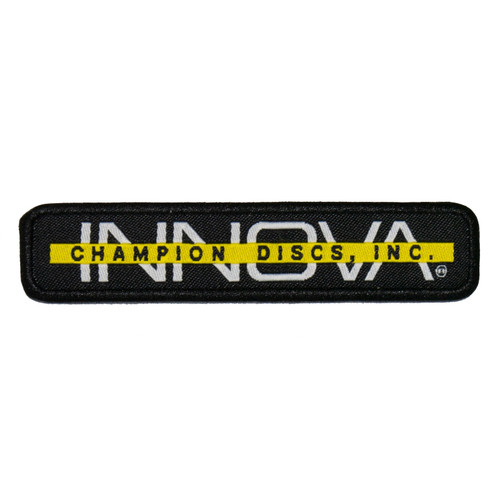 """Innova Bar Stamp Patch. Shows a long rectangular patch with black background. The word INNOVA is white and capitalized, and a yellow bar goes across center of the letters. The bar has """"Champion Discs"""" written in black."""