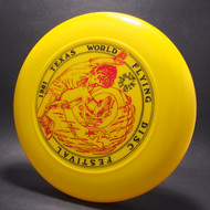 Sky-Styler 1981 Texas Flying Disc Festival Yellow w/ Black Matte and Metallic Red Top View