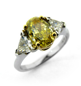 Oval Yellow Diamond & Trillant Diamond Ring (21500.00)