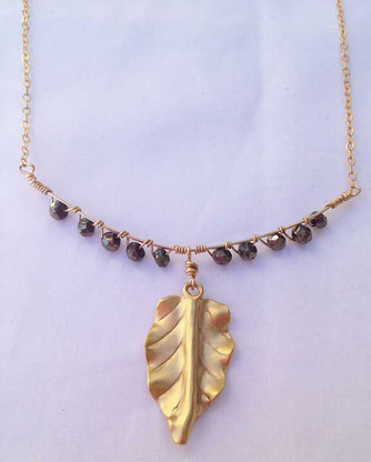 14K gold plated leaf charm bib necklace.  Classic stylish piece that will dress up any jeans and a t-shirt or little black dress!  Colors can be worn with any color combo! 16 inch with a two inch extend chain to 18 inches.