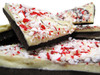 Peppermint Bark: White Chocolate blended with peppermint oil and crushed candy canes. Decorated with milk and dark chocolate.