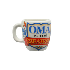 """Decorative ceramic mug kitchen magnet featuring the saying """"Oma is the Greatest"""" Material: Ceramic"""