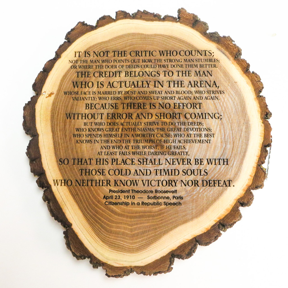 Famous quote personalized log slice plaque.