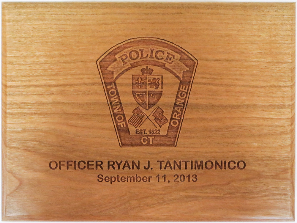 Custom Police patch engraved on large wood box.