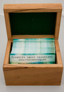This hinged box includes laser engraving an image on it's top and felt lining in the inside.