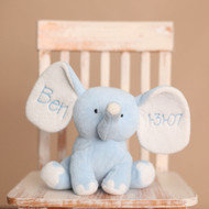 Monogrammed light blue elephant with the designer new font and blue thread.