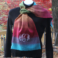 Colorful scarf with monogrammed initials in white thread and the monogram script font.