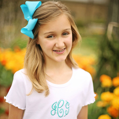 Turquoise Julia extra large 5 X 6 hair bow on a french clip.