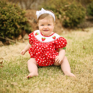 Red with white polka dots fabric smocked strawberry bubble is adorable with  a full body and sleeves.
