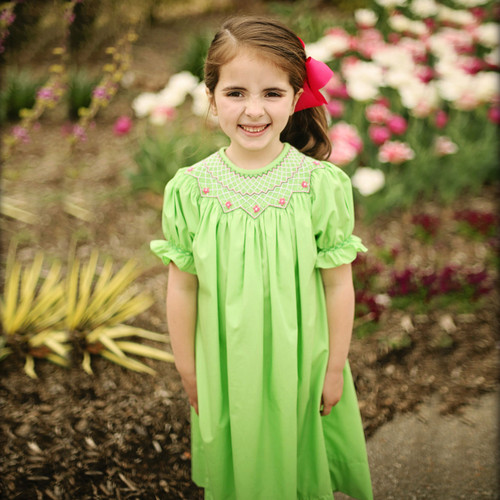 Smocked bishop made with lime green fabric and smocked hot pink smocked roses on the neck.