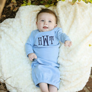 Monogrammed sky blue baby gown in the Monogram Serif font with navy thread.