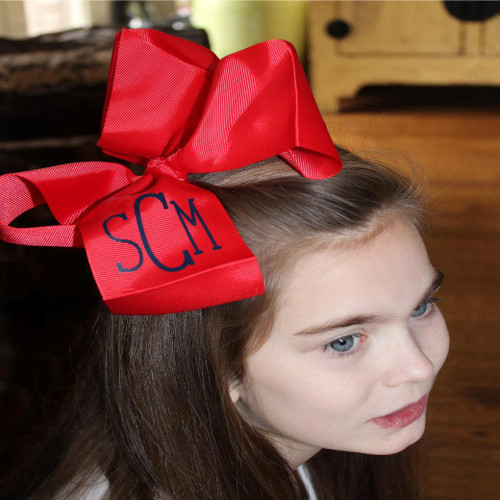 Stella monogrammed red 7 x 8 hair bow on an alligator clip.