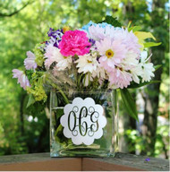 Square flower vase with a silver monogram decal.