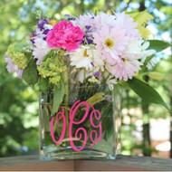 Monogrammed flower vase with hot pink initials.