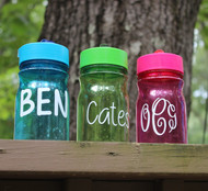 Toddler sippy cups with a decal.