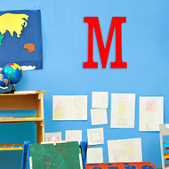 Block letter M painted red.