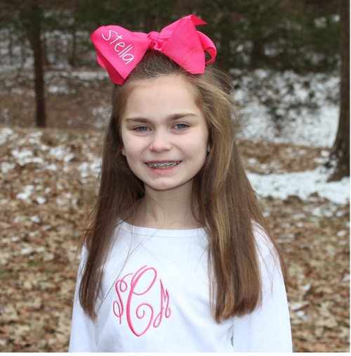 Stella hair bow monogrammed with her name.