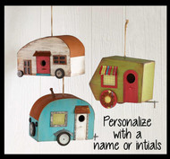 The camper birdhouse is made of distressed wood with tin accents. Personalize with a name, initials or year.