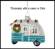 Beautiful hand blown glass camper Christmas ornament.