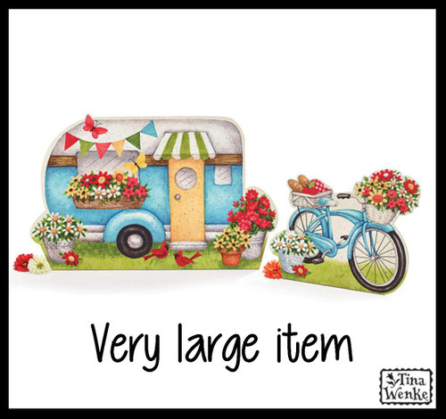 Large camper and bicycle with flowers decor piece.