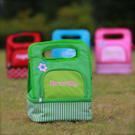 Green/pink flower, red ladybug and blue/flower lunchboxes monogrammed with names and initials.