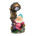 Solar Powered Gnome Next to a Tree Spotlight