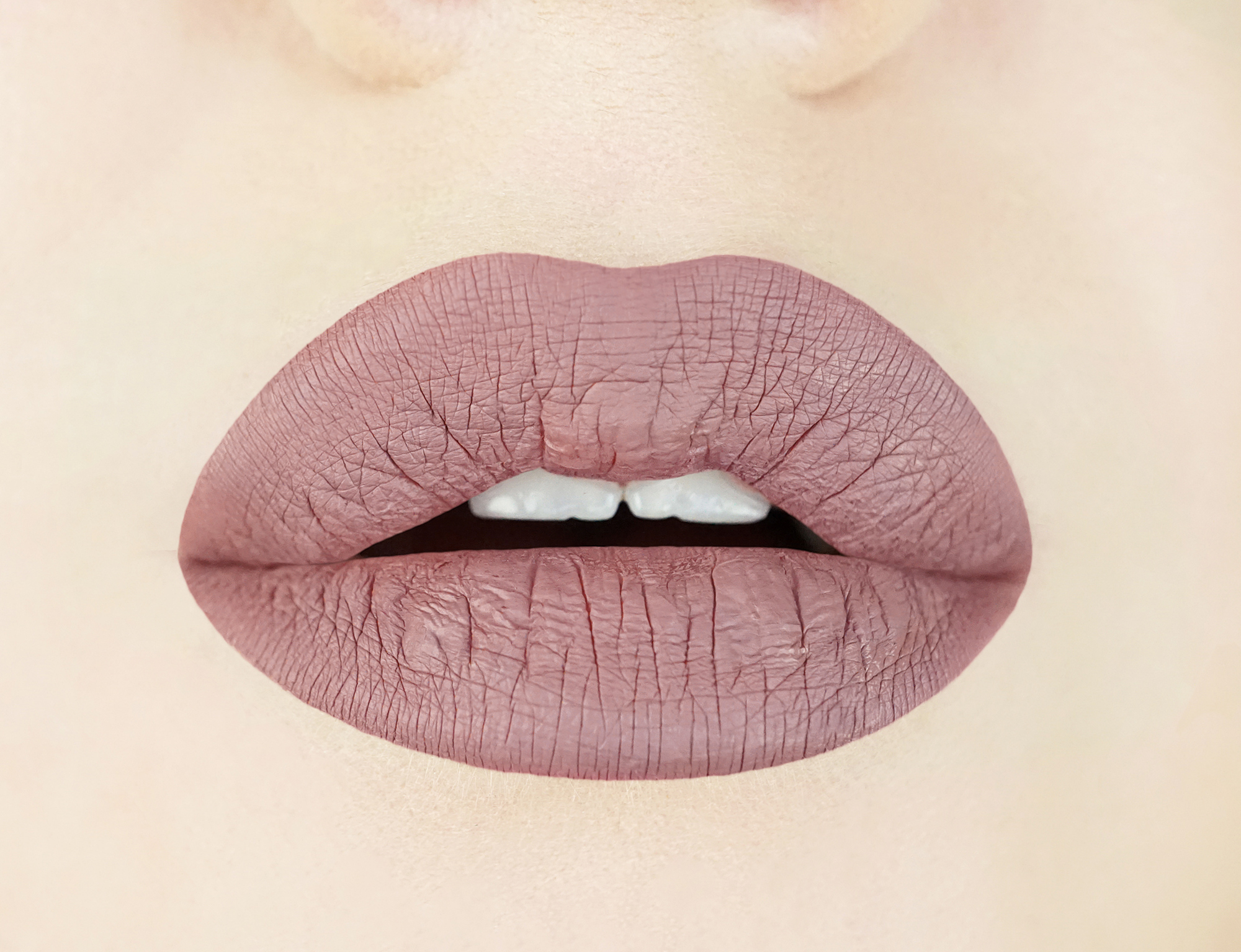 Swatch of Aromi Desert Taupe Liquid Lipstick