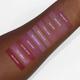 Aromi pink liquid lipsticks swatched on darker skin